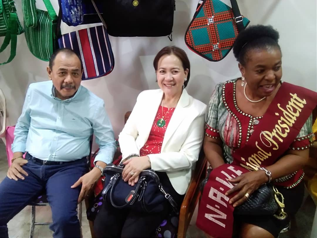 In company of Ambassador of the Philippines and spouse at the shop opening event of a NAWE Member