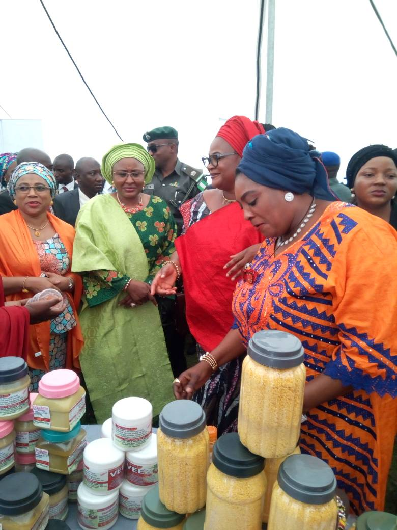 Aisha Buhari visiting NAWE Cosmetics on Display at women's fair Abuja.